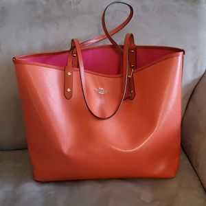 Coach orange & hot pink reversible leather tote
